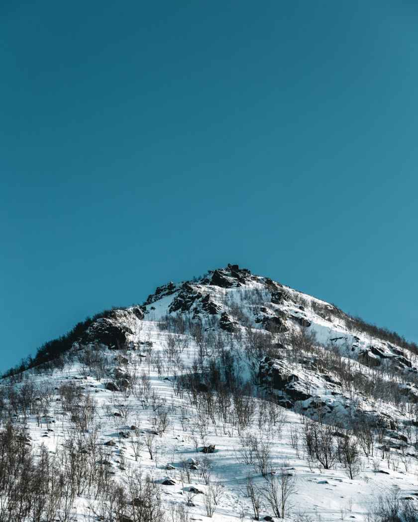 view of mountain under blue sky